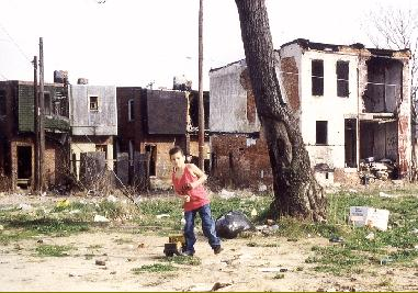 Kids playing in their burned down neighbourhood, Philadelphia, PA USA